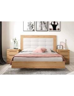 Dormitorio de matrimonio con cabecero tapizado en polipiel